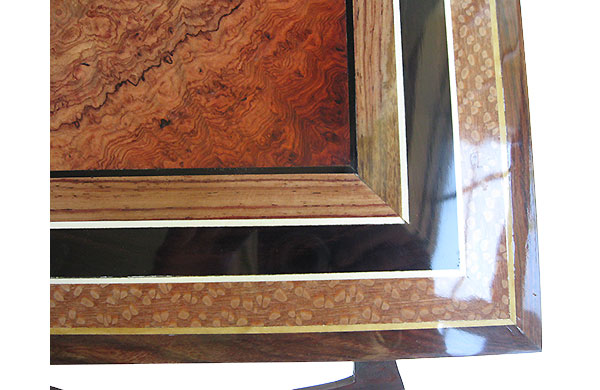 Amboyna burl center framed in Honduras rosewood, African blackwood and lacewood box top - close up
