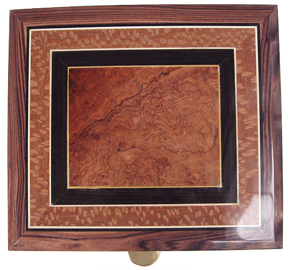 Handcrafted wood box top with amboyna burl center  framed in African black wood and lacewood