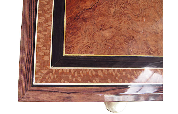 Amboyna burl center framed in African blackwood and lacewood box top close up - Handcrafted wood keepsake box