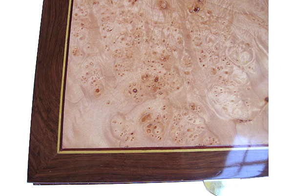 Maple burl center framed in Madagascar rosewood box top close up