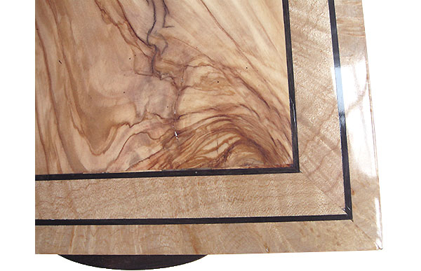 Mediterranean olive center framed in maple burl box top close up