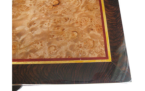 Handcrafted box top close-up - Maple burl center framed in African blackwood with Ceylon satinwood and bloodwood striping