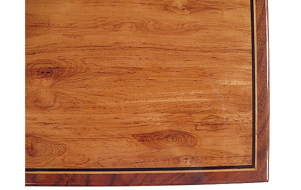 Decorative valet box box top close up - Highly figured Honduras rosewood with ebony and satinwood striping in a walnut frame