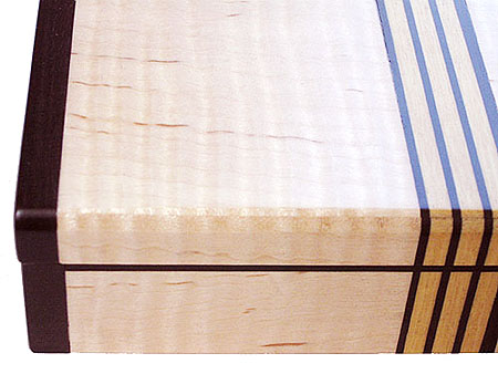 Decorative small wood box close up - Fiddle back maple, ebony, Ceylon satinwood