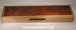 Camphor burl top on cherry box body and top frame