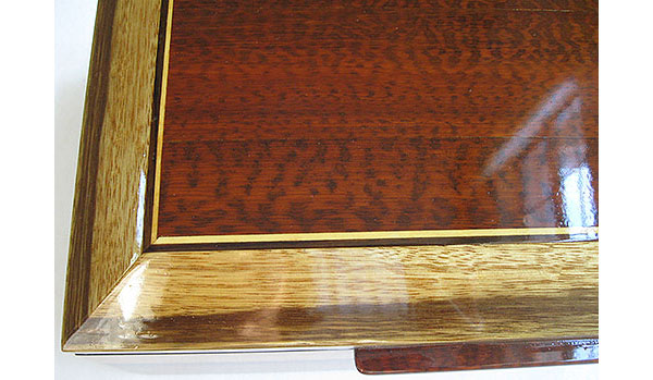 Beveled box top close-up - Snakewood framed in black limba