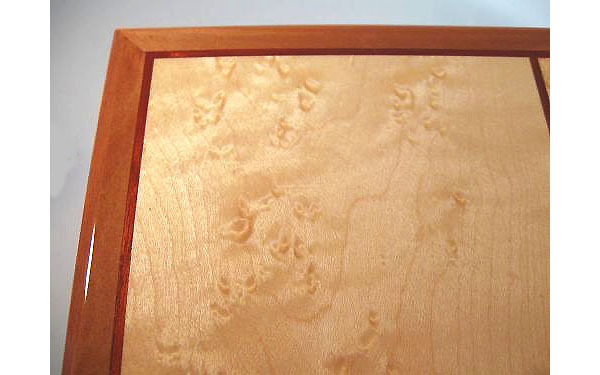 Men's valet box handcrafted from pearwood with birds eye maple top - Close up view