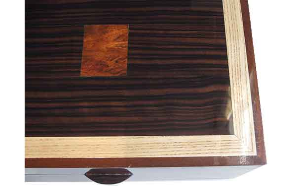 Macassar ebony with bloodwood burl inlay framed in ash and mahogany box top - close up
