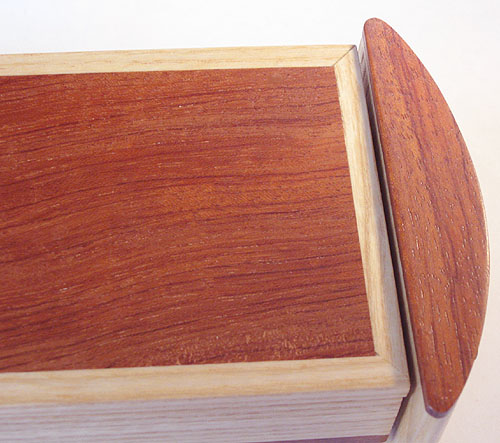 Handmade decorative wood weekly pill box close up - Bubinga and elm wood